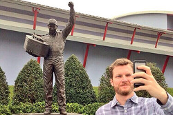 Dale Earnhardt Jr., Hendrick Motorsports Chevrolet takes a selfie in front of a statue of his father