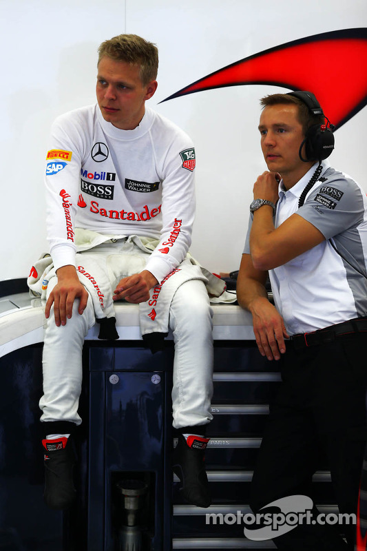 (L to R): Kevin Magnussen, McLaren with Antti Vierula, Personal Trainer