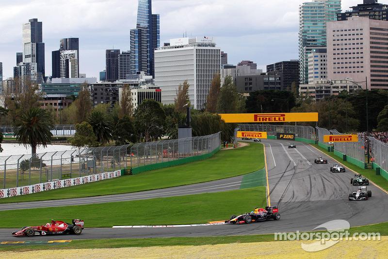 Fernando Alonso, Ferrari F14-T leads Sebastian Vettel, Red Bull Racing RB10