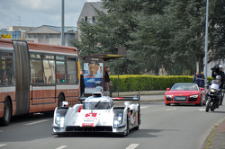 Tom Kristensen drives the Audi R18 e-tron quattro through the streets of downtown Le Mans
