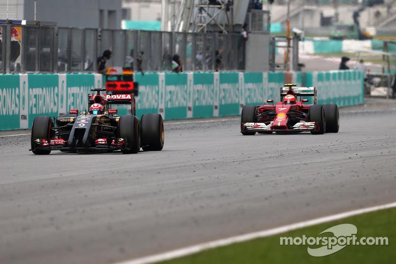 Romain Grosjean (FRA), Lotus F1 Team e Kimi Raikkonen (FIN), Scuderia Ferrari 30