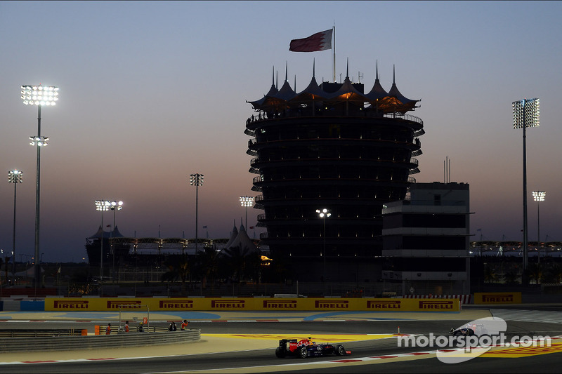 Daniil Kvyat, Scuderia Toro Rosso STR9 leads Sebastian Vettel, Red Bull Racing RB10