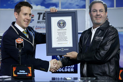 Texas Motor Speedway President Eddie Gossage is presented a Guinness World Records certificate for the