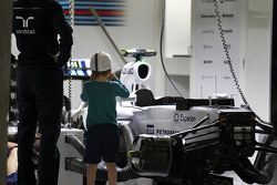 A boy photographs the Williams FW36 of Valtteri Bottas, Williams FW36 in the pits