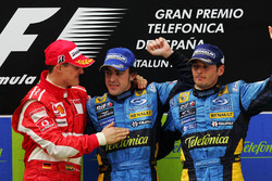 Podium: race winner Fernando Alonso, Renault, second place Michael Schumacher, Ferrari and third place Giancarlo Fisichella, Renault