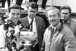 Race winner Jim Clark, Lotus, receives the winners trophy with team boss, Colin Chapman on the podium