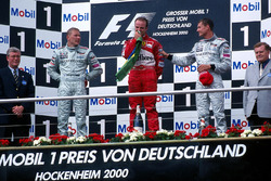 Mika Hakkinen, McLaren 2nd, race winner Rubens Barrichello, Ferrari and David Coulthard, McLaren 3rd on the podium