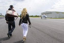 Kurt Busch and girlfriend Patricia Driscoll arrive at Concord Regional Airport as he travels back from Indianapolis Motor Speedway to run the Sprint All Star race