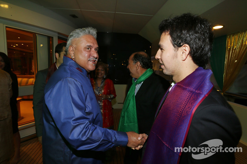 (L to R): Dr. Vijay Mallya, Sahara Force India F1 Team Owner with Sergio Perez, Sahara Force India F1 at the Signature Monaco Party