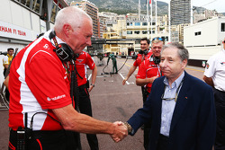 (L to R): John Booth, Marussia F1 Team Team Principal and Jean Todt, FIA President celebrate Jules Bianchi, scoring the team's first F1 points