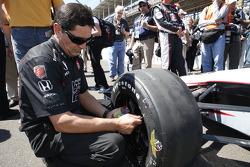 A crew member works on Kurt Busch's car