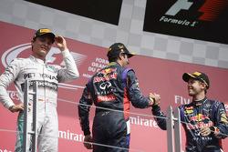 Daniel Ricciardo, Nico Rosberg and Sebastian Vettel celebrate on the podium