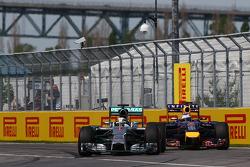 Lewis Hamilton, Mercedes AMG F1 W05 and Sebastian Vettel, Red Bull Racing RB10 battle for position