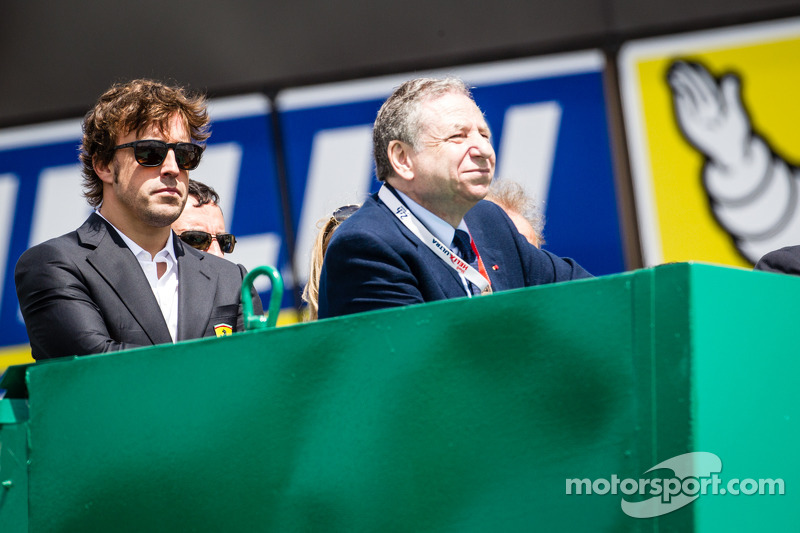 Fernando Alonso and Jean Todt watch the race from the starter stand