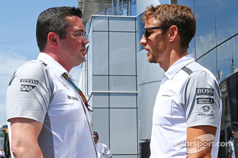 (L to R): Eric Boullier, McLaren Racing Director with Jenson Button, McLaren
