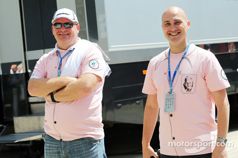 Fans in the paddock wear Pink for Papa clothing in memory of John Button, McLaren