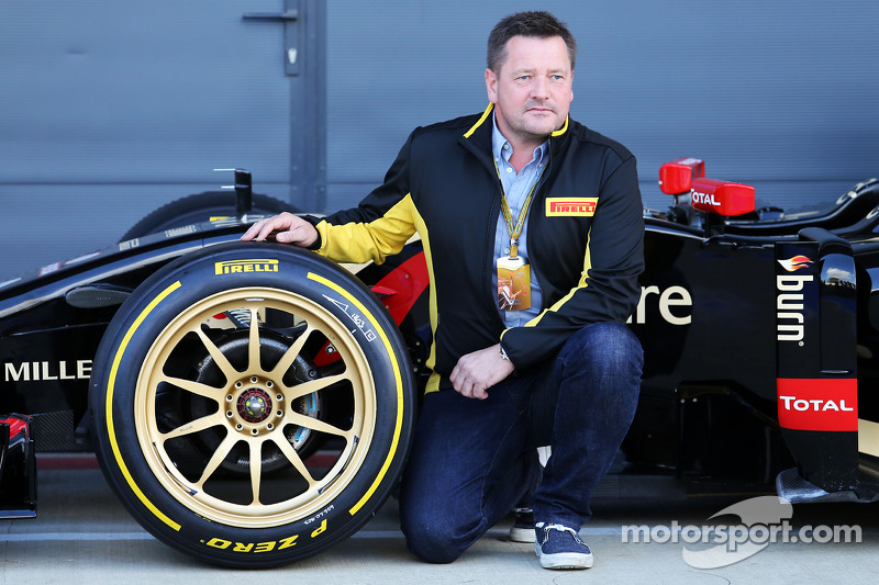 Paul Hembery, Pirelli Motorsport Director and the Lotus F1 E22 with new 18 inch Pirelli tyres and rims