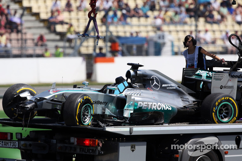 The Mercedes AMG F1 W05 of Lewis Hamilton, Mercedes AMG F1 is recovered back to the pits on the back of a truck after he crashed out of the first session of qualifying