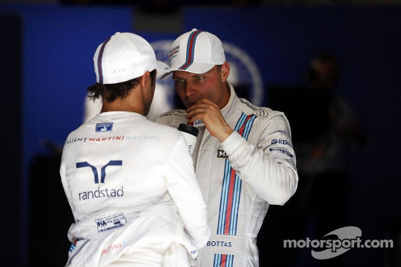 (L to R): Third placed Felipe Massa, Williams in qualifying parc ferme talks with second placed team mate Valtteri Bottas, Williams