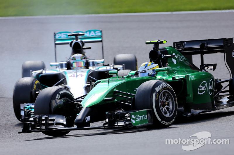 Marcus Ericsson, Caterham F1 Team; Lewis Hamilton, Mercedes AMG F1 Team