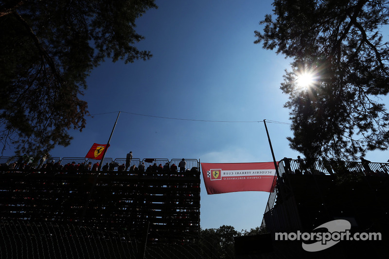 Fans and Ferrari flags in the grandstand