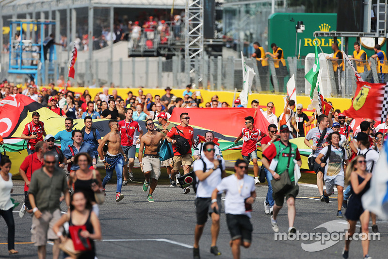 Fans invade the circuit after the end of the race