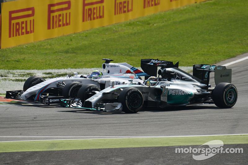 Felipe Massa, Williams FW36 and Lewis Hamilton, Mercedes AMG F1 W05 battle for position