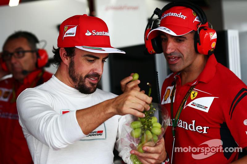 (L to R): Fernando Alonso, Ferrari with Marc Gene, Ferrari Test Driver
