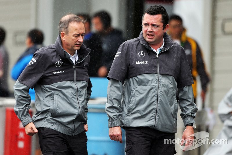 (L to R): Jonathan Neale, McLaren Chief Operating Officer and Eric Boullier, McLaren Racing Director in a wet and rainy paddock
