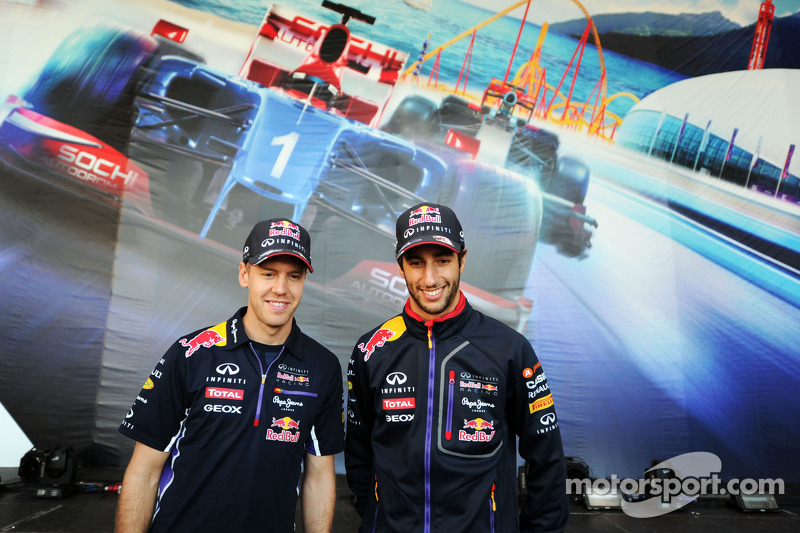(L to R): Sebastian Vettel, Red Bull Racing and team mate Daniel Ricciardo, Red Bull Racing sign autographs for the fans at the Fanzone