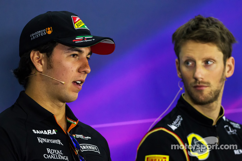 Sergio Pérez, Sahara Force India F1 con Romain Grosjean, Lotus F1 Team en la conferencia de prensa de la FIA