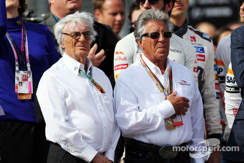 (L to R): Bernie Ecclestone, with Mario Andretti, Circuit of The Americas' Official Ambassador on the grid