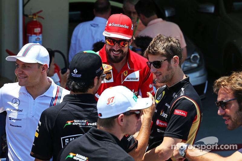 Fernando Alonso, Ferrari with Sergio Perez, Sahara Force India F1 and Romain Grosjean, Lotus F1 Team