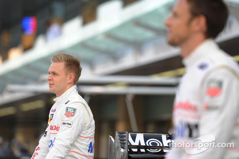 (L to R): Kevin Magnussen, McLaren and Jenson Button, McLaren at a team photograph