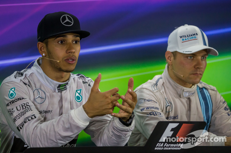 (L to R): Race winner and World Champion Lewis Hamilton, Mercedes AMG F1 with Valtteri Bottas, Williams in the FIA Press Conference