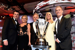 Rodney Childers, Katrina Childers, Gene Haas, DeLana Harvick and Kevin Harvick pose with the championship trophy