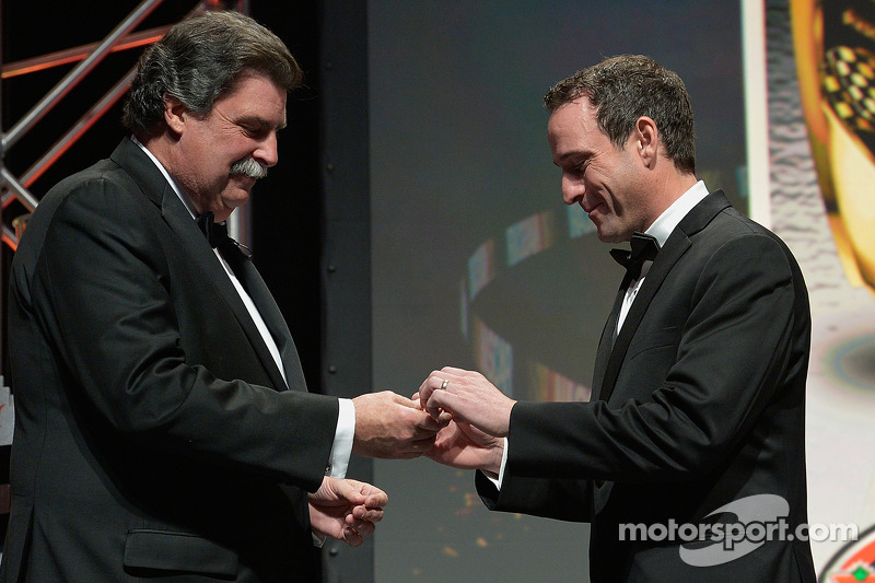 NASCAR Canadian Tire Series champion Louis-Philippe Dumoulin gets a championship ring from NASCAR president Mike Helton
