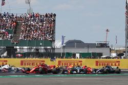 Sebastian Vettel, Ferrari SF71H leads as Kimi Raikkonen, Ferrari SF71H and Lewis Hamilton, Mercedes-AMG F1 W09 collide at the start of the race