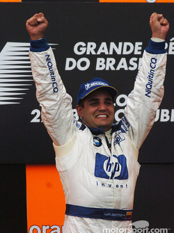 Podium: race winner Juan Pablo Montoya celebrates