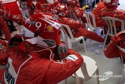 Ferrari team members watch the race
