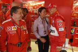 Michael Schumacher and Jean Todt celebrate pole position