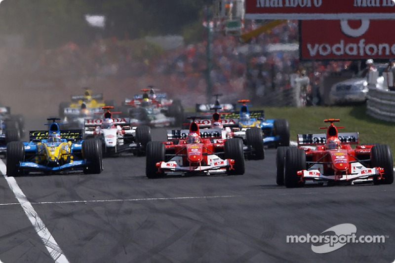Start: Michael Schumacher takes lead ve Rubens Barrichello ve Fernando Alonso