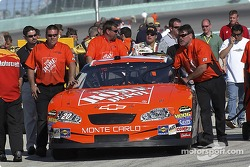The Home Depot Chevrolet crew push the car to the qualifying line