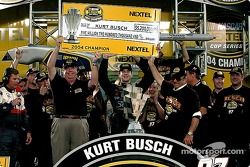 Kurt Busch accepts the big check