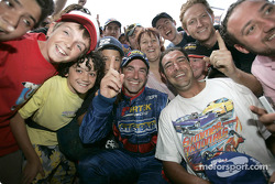 Australian V8 Supercar Series 2004 champion Marcos Ambrose celebrates with his fans after winning Race 1