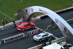 A Peugeot 307 WRC against a Ferrari 360 Modena Challenge