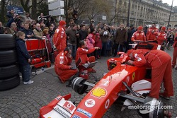 Parade on Champs-Elysées: Ferrari crew members prepare the Ferrari F2004 F1