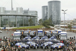 Volkswagen Motorsport's departure for Barcelona: team members pose