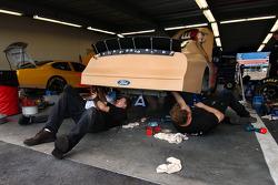 Sadler's crew works on the car