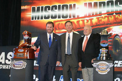Ediie Gossage, Bruton Smith and Brian France with the two Nextel Cup trophies for Texas Motor Speedway